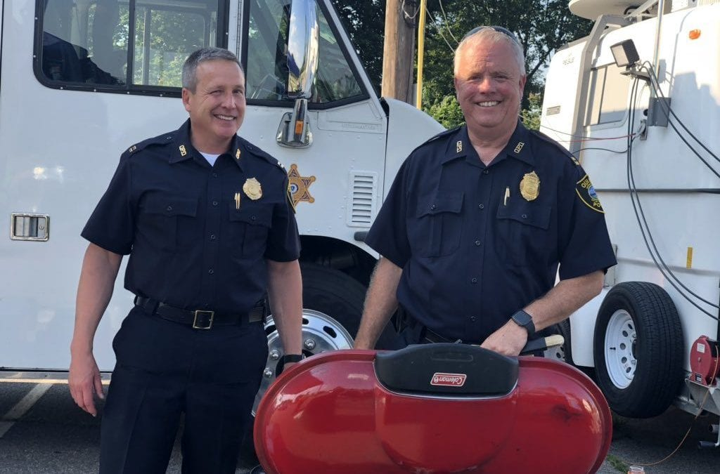 Quincy Police Captains Miller and Dougan manning the grill to feed the police officers working Hough's Neck Fourth of July fireworks display
